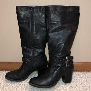 Tall black studded buckled boots. Very cute!